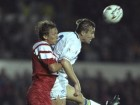 Guido Buchwald of Stuttgart jumps to tackle Lee Chapman of Leeds