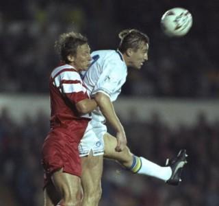 Guido Buchwald of Stuttgart jumps to tackle Lee Chapman of Leeds